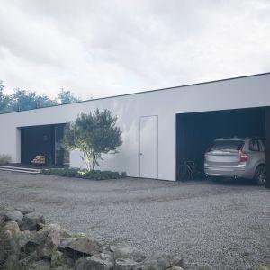 W bryłę domu wkomponowano także wiatę garażową na jeden samochód. Projekt: pracownia HomeKONCEPT