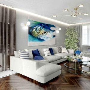 Nowoczesny salon z wygodną strefą relaksu. Projekt Tissu Architecture