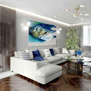 Elegancka ciemna jodełka na podłodze w salonie dobrze wygląda z szarym kolorem ściany. Projekt: Tissu Architecture