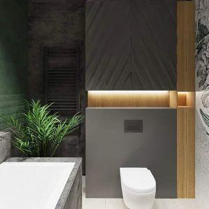 Z kolei pracownia Chrobotek Design sięgnęła po butelkową zieleń płytek Green Show Opoczno, którą przełamano grafitową imitacją betonu Quenos Graphite, tworząc niezwykle odważną i wyrazistą kompozycję okładzin. Projekt CHROBOTEK DESIGN
