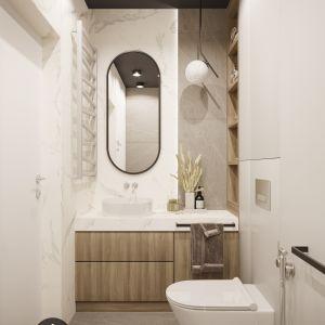 W projekcie studia IN POINT  ponadczasową aranżację inspirowaną japońską estetyką tworzy oryginalny zestaw materiałów: biały marmur, płytki Noisy Grey o matowej powierzchni i wzorze szarego kamienia oraz drewno. Projekt IN POINT