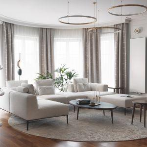 Okrągły dywan dobrze prezentuje się w reprezentacyjnym salonie. Projekt JT Group
