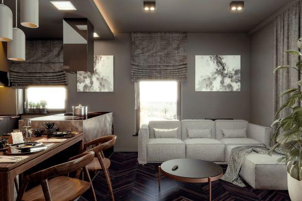 Ciemne, minimalistyczne wnętrze jest bardzo przytulne. Znajdziemy w nim elementy miedzi i przyjemnych struktur kafli, drewna, spieków i tkanin. Wszystko w idealnie, pięknie skrojonych proporcjach.