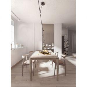 Serce apartamentu stanowi centralnie ustawiony stół wraz z zabudową kuchenną. Projekt i wizualizacje: Aga Kobus i Grzegorz Goworek, pracownia Studio. O.