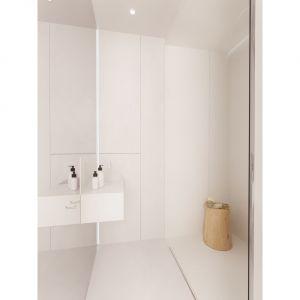 Apartament został utrzymany w duchu luksusowego minimalizmu, co sprawia, że przestrzeń jest wolna od nadmiaru bodźców. Projekt i wizualizacje: Aga Kobus i Grzegorz Goworek, pracownia Studio. O.