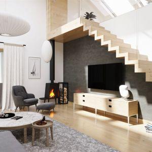 W aranżacji wnętrza wykorzystano ponadczasową biel, ładnie połączoną z modną szarością i drewnem. Atrakcyjnego pazura dodają całości oryginalne lampy. Projekt: pracownia Archipelag