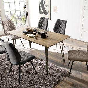 Masywny stół dobrze jest przełamać miękkością tapicerowanych krzeseł, które są niezwykle wygodne i stylowe. Fot. Iguane.pl