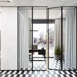 Drzwi z przeszkleniami ujętymi w stalowe czarne ramy wydzielają przestrzeń, jednocześnie jej nie zamykając. Projekt wnętrza: Paweł Łęczycki, modeko.studio