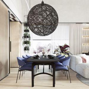 Nad stołem w jadalni znalazła się piękna duża lampa Random projektu Bertjana Pota dla Moooi. Projekt wnętrza: Paweł Łęczycki, modeko.studio