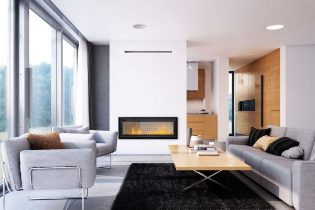 Nic nie tworzy we wnętrzu tak cudownego, domowego klimatu, jak kominek. Salon pięknie wygląda w blasku żywego ognia, ciepło przyjemnie rozchodzi się po domu, a zapach płonących szczap drewna sprawia, że czujemy się bezpiecznie, wyjątkowo.Jak