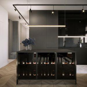Nowoczesna, czarna przestrzeń to marzenie wielu miłośników designu, a stworzenie takiej jest możliwe między innymi za sprawą eleganckiej wyspy kuchennej wykonanej z granitu oraz mebli zaprojektowanych w spójnej do wyspy kolorystyce. Projekt i zdjęcia: Moovin Interiors