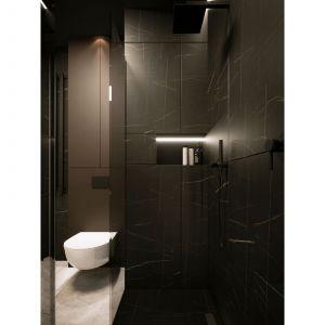W apartamencie zaprojektowano dwie łazienki, które zostały utrzymane w tej samej, spójnej kolorystyce czerni i bieli. Projekt i zdjęcia: Moovin Interiors