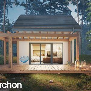 Domek letniskowy w krokusach - projekt z pracowni Archon. Powierzchnia zabudowy: 34,73 m2. Projekt: Archon