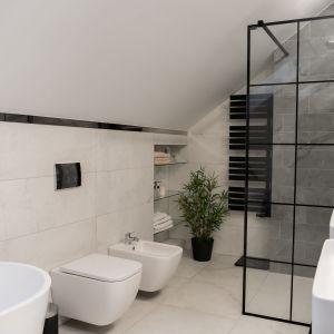Łazienka na piętrze zaprojektowana jest w biało-szarej kolorystyce. Projekt: Donata Gadalska, DG Studio. Fot. Jacek Fabiszewski