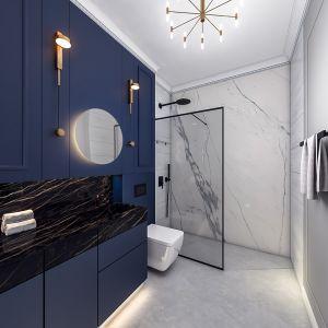Łazienka mieści kabinę prysznicową walk-in, wc i umywalkę, która jest monolityczna z blatem i wykonana ze spieku kwarcowego. Projekt i wizualizacje: Monika Staniec
