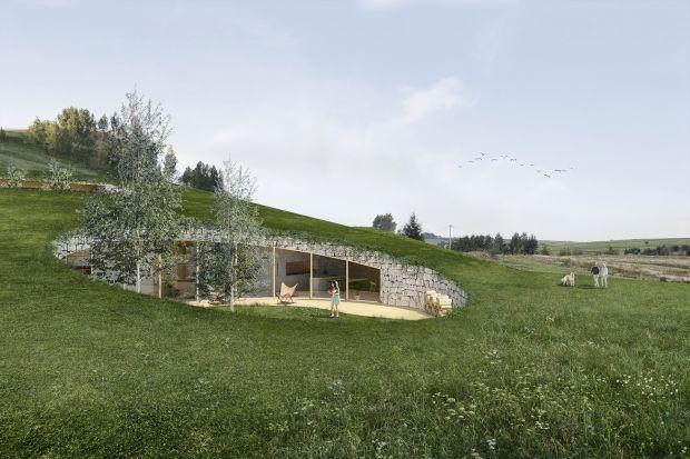 Podstawowymi założeniami projektu było dopasowanie domu do kontekstu, bliskość z naturą oraz zachowanie intymności przyszłych mieszkańców. Budynek od zachodu i południa wydaje się być całkowicie niewidoczny. Zielony dach dostosowany do natur