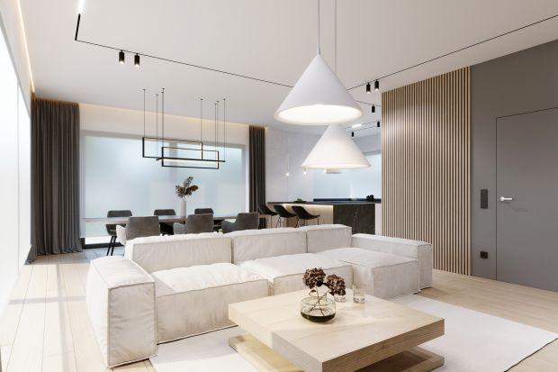 Projekt domu w Piotrkowie Trybunalskim powstał dla młodego małżeństwa w małym dzieckiem. Wnętrze miało być w pełni komfortowe, przyjazne do życia, aktywności i odpoczynku. Architekci postawili więc na styl minimalistyczny, w którym wykorzyst