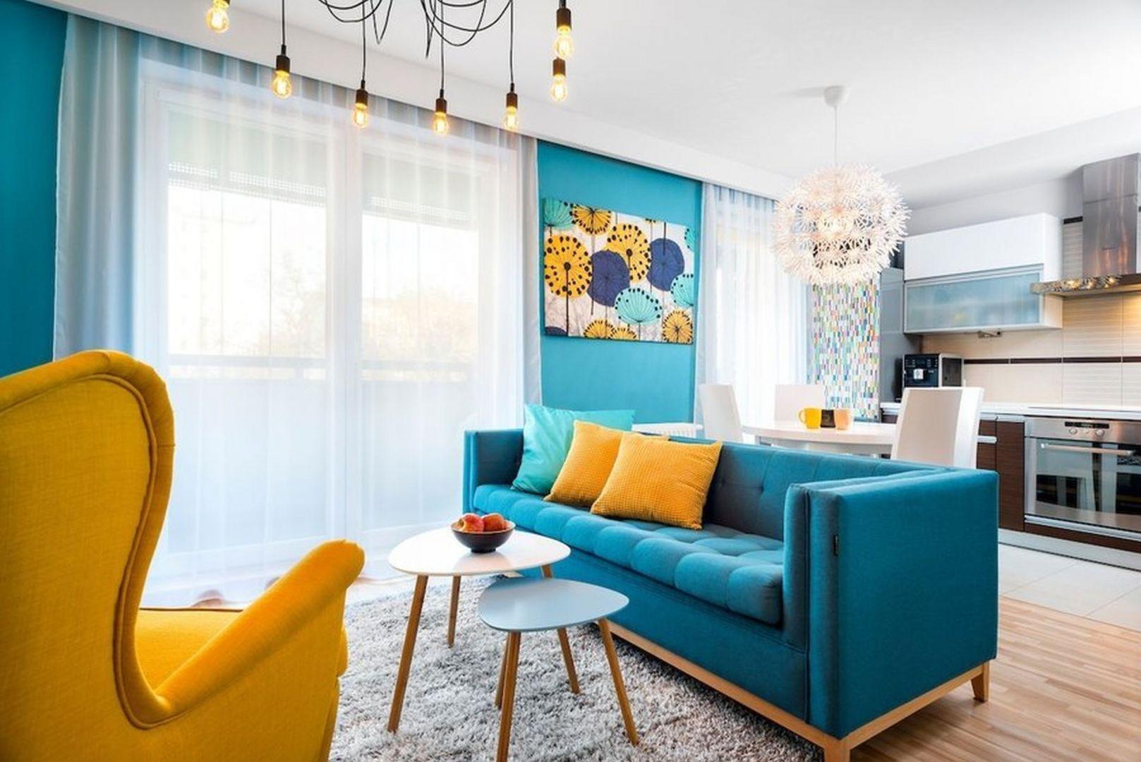 Ściana w salonie w kolorze turkusowym. Autorka projektu: Krystyna Dziewanowska, pracownia Red Cube Design. Zdjęcia: Mateusz Torbus 7TH IDEA.jpg