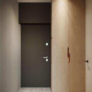 Przedpokój z fornirowanym drewnem i lamelami. Projekt: Sara Tokarczyk i Wojciech Poziomka, Studio Smart Design