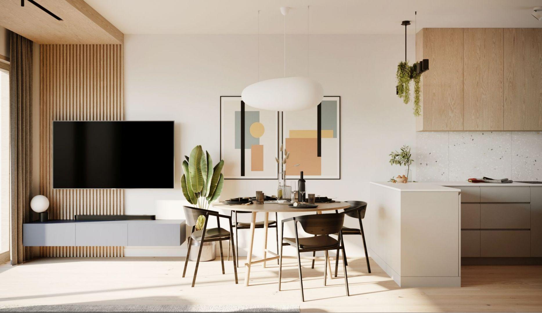 Przy aneksie kuchennym stanął okrągły drewniany stół i krzesła w stylu vintage. Projekt: Sara Tokarczyk i Wojciech Poziomka, Studio Smart Design