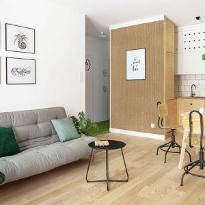 Zielone dodatki świetnie dopełniają jasne wnętrze. Projekt: Maka Studio (Daria Pawlaczyk, Aleksandra Kurc). Fot. Tom Kurek