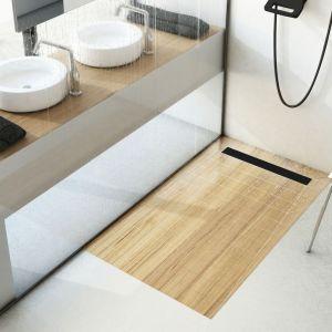 Czarny odpływ łazienkowy to nowoczesny detal, który świetnie będzie się prezentował w jasnej łazience. Fot. Schedpol