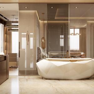 Piękna łazienka przy sypialni ze spektakularną wanną wolnostojącą. Projekt i zdjęcia: Covet House
