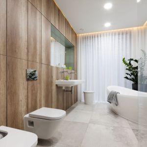 Drewno w łazience zawsze nada jej naturalnego charakteru. Projekt Dariusz Grabowski. Fot. Bartosz Jarosz