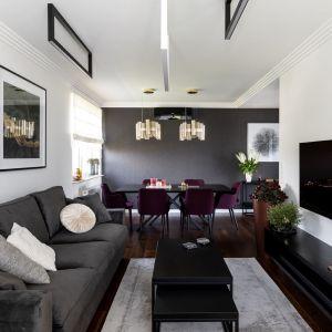 Elegancki salon z jadalnią w tle. Projekt Dekorian Home x Architaste. Fot. Dominika Wilk