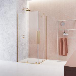 Złota armatura, kabina prysznicowa czy parawan nawannowy z okuciami w tym kolorze, to modny pomysł do łazienki. Fot. Radaway