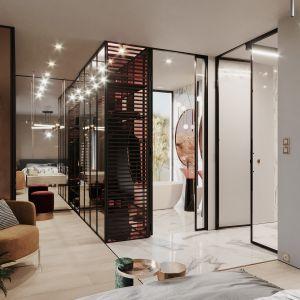 Naprzeciwko łóżka, po drugiej stronie wejścia, znalazły się garderoba i łazienka. Projekt Modeko.studio
