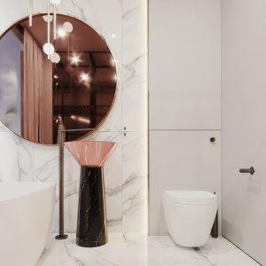 Kontrastuje z nią z kolei geometryczna umywalka przypominająca rzeźbę, którą zaprojektował Antonio Lupi. Projekt Modeko.studio