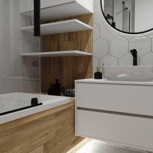 Łazienkowe trendy. Panująca w projekcie biel jest doskonałym tłem dla drewnianych motywów.  Projekt: Justyna Nabielec. Fot. Luxrad