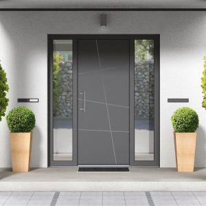 Odpowiednio dobrane drzwi wejściowe to także jeden z czynników wpływających na wycenę inwestycji. Na zdjęciu: drzwi zewnętrze z kolekcji Avangarde. Fot. Awilux