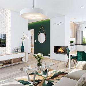 W salonie mamy wolną ścianę telewizyjną i kominek narożny na osobnej ścianie. Projekt: arch. Michał Gąsiorowski. Fot. MG Projekt