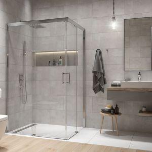 Łazienka z prostokątną kabiną prysznicową narożną Free Zone w wersji bez brodzika. To rozwiązanie zapewnia bezbarierowe wejście i wyjście ze strefy prysznica. Co istotne sama kabina nie ma profilu dolnego, co pozwala połączyć wizualnie ją z resztą łazienki. Fot. Sanplast