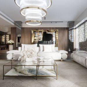 W przestrzeni wypoczynkowej znajdują się sofy Donovan z najnowszej kolekcji Beauty by Visionnaire pokryte tkaniną w połączeniu z nubukiem w kolorze złamanej bieli. Projekt: Katarzyna Weremczuk, Weremczuk Design. Fot. Złota 44