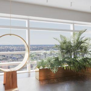 Na uwagę zasługuje we wnętrzu minimalistyczne siedzisko o okrągłej formie, z którego warto podziwiać panoramę miasta. Projekt: Katarzyna Weremczuk, Weremczuk Design. Fot. Złota 44