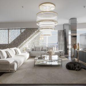 Eleganckie oprawy oświetleniowe marki Visionnaire potęgują blask apartamentu. Projekt: Katarzyna Weremczuk, Weremczuk Design. Fot. Złota 44