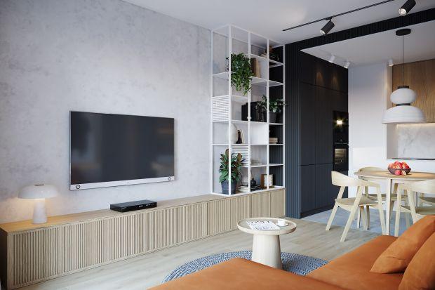 Nowoczesny i funkcjonalny projekt tego mieszkania zwraca uwagę stonowaną kolorystyką, przemyślanym układem oraz ciekawymi pomysłami na zabudowę. Ryflowane fronty szaf - piękne!