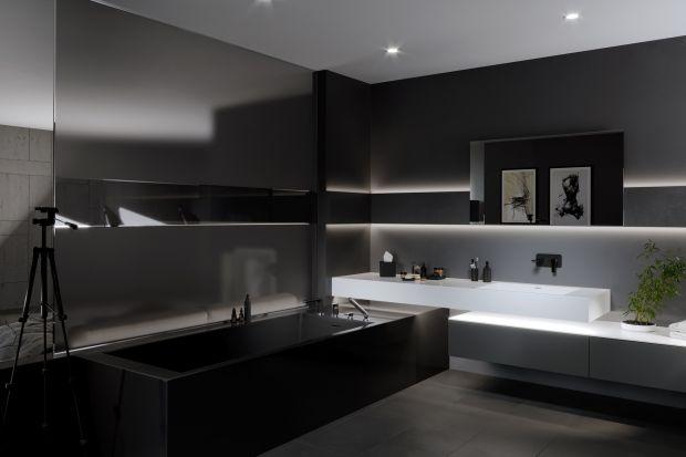 W tej łazience projektant postanowił odwrócić proporcje i dać przewagę czerni, która – jak się okazuje – też potrafi być wybornym tłem.