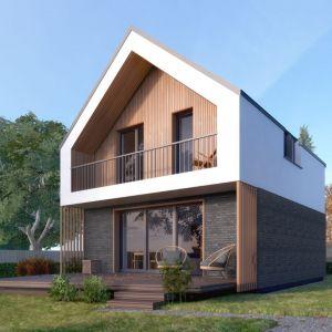 Budynek z dwuspadowym dachem o stonowanej estetyce w projekcie Mandarynka może harmonijnie współgrać zarówno z otoczeniem miejskim, jak i naturalnym. Autor projektu arch. Tomasz Sobieszuk, pracownia DOMYwStylu.pl