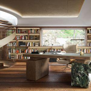 W gabinecie stanęło biurko z drewna i kamienia, zaprojektowane na zamówienie, powstała także miła przestrzeń do spotkań, którą tworzą sofa, fotele i niewielki stolik. Projekt: Joanna Kulczyńska. Wizualizacje: Blok Studio