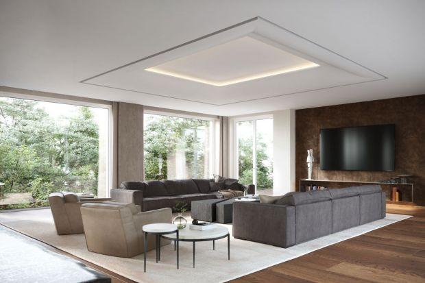 Wnętrze tej przestronnej willi jest eleganckie,stylowe,wysmakowane i konsekwentne. To zasługastarannie dobranej palety kolorów i materiałów.We wszystkich pomieszczeniach królują neutralne beże, ciemny odcień drewnaoraz mosiądz.