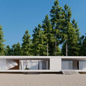 Prosta, minimalistyczna bryła domu, dzięki białej elewacji i dużym przeszkleniom dopełnia wspaniały krajobraz działki. Projekt: pracownia Core