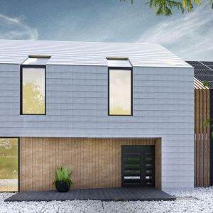Bryły pełniące różne funkcje (część mieszkalna oraz część garażowa) zostały zróżnicowane kolorem materiału elewacyjnego. Projekt: Duch Projektanci