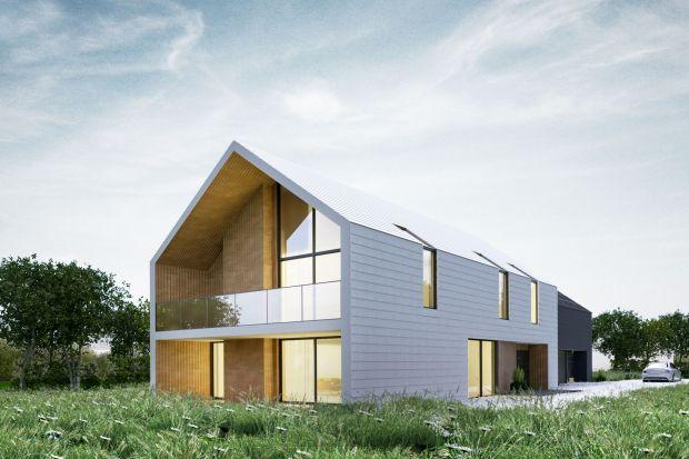 Dom zostałzaprojektowany jako połączenie dwóch brył.Maprostą, nowoczesną formę o minimalistycznym wydźwięku.Funkcjonalnie także podzielony jestnaczęści: mieszkalną oraz garażową.<br /><br /><br />