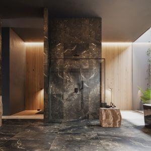 Zieleń, brązowo-zielone kamienne ściany oraz dominujące, wykute w blokach kamienia meble doskonale komponują się z nowoczesną kolekcją armatury OMNIRES BARETTI w czarnym, matowym wykończeniu. Fot. Omnires