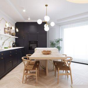 Kuchnia jest elegancka i nowoczesna. Głównym punktem są granatowe meble, które pomalowano farbą Farrow&Ball. Projekt i wizualizacje: Tomasz Kaim, Agnieszka Drużkowska, kaim.work