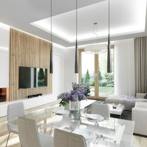 Dom, biorąc pod uwagę niewielką powierzchnię użytkową, jest bardzo funkcjonalny i ma rozbudowany program pomieszczeń. Projekt: arch. Michał Gąsiorowski. Fot. MG Projekt